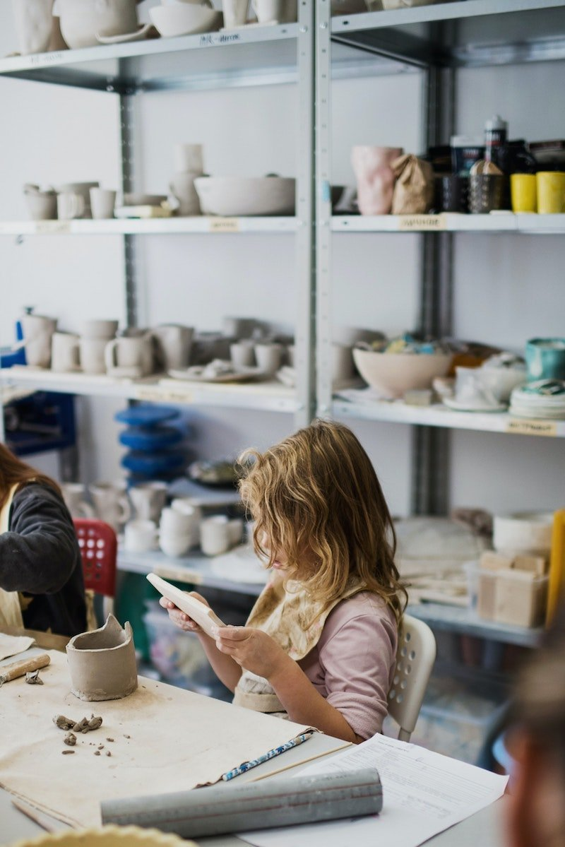 girl in pottery class