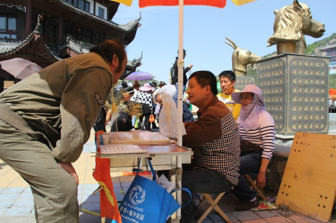 sugar painting art in china man on stall