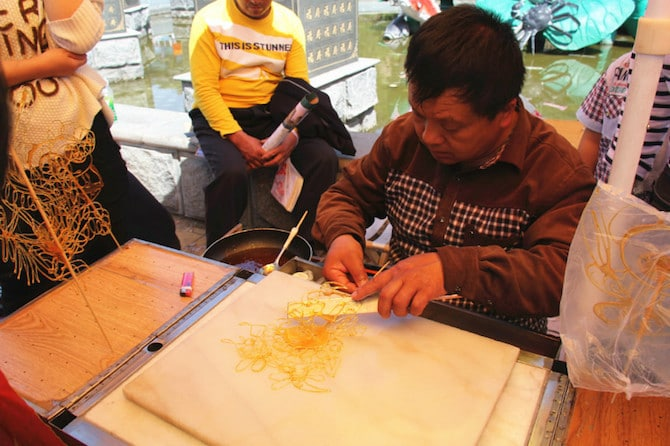 sugar painting art in china on stick