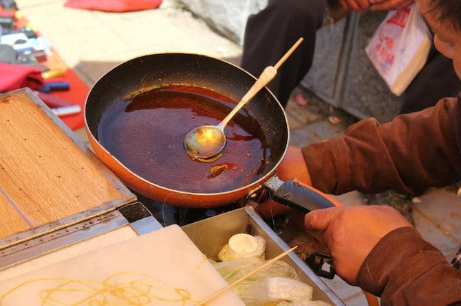 sugar painting art in china pan on stove