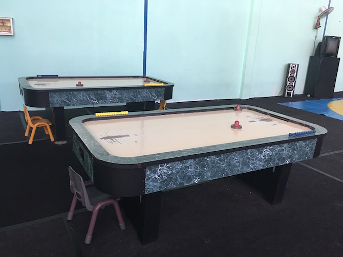 Visit Roam the Gnome Family Travel Directory for MORE SUPER DOOPER FUN ideas for family travel. Search by City. Photo- Bali Fun World air hockey