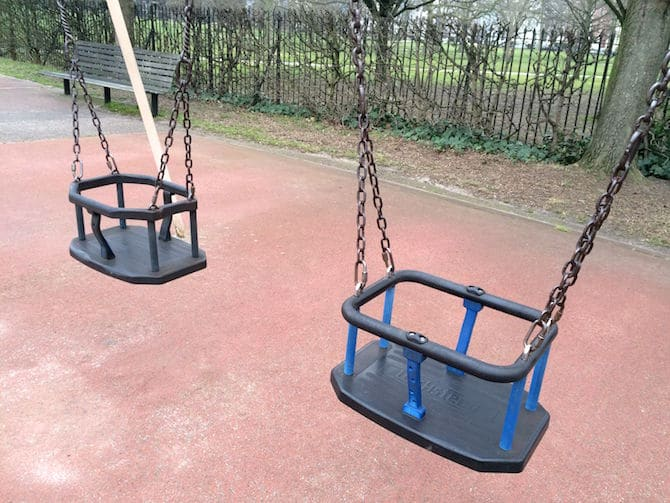 Primrose Hill Playground swings. Visit ROAM THE GNOME FAMILY TRAVEL WEBSITE. Hundreds of fun ideas & activities to help you plan & book your next family vacation or weekend adventure