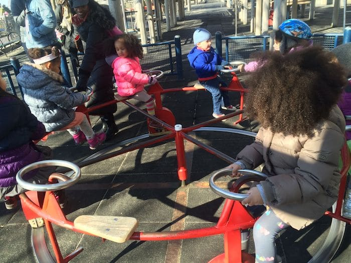 Merry go round at Rockefeller Park Playground NYC ROAM THE GNOME Family Travel Website. Hundreds of fun ideas and activities to help you plan and book your next family vacation or weekend adventure