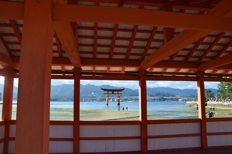 hiroshima day trip to miyajima island view of red torii gates from shrine pic