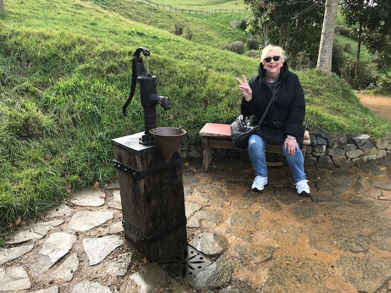 hobbiton movie set tours in new zealand - mum sitting at rest area pic