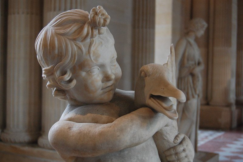 louvre museum with kids sculpture of child and duck pic