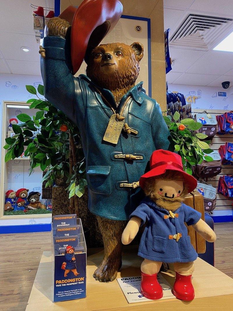 paddington bear shop in london statue in shop with roam the gnome pic